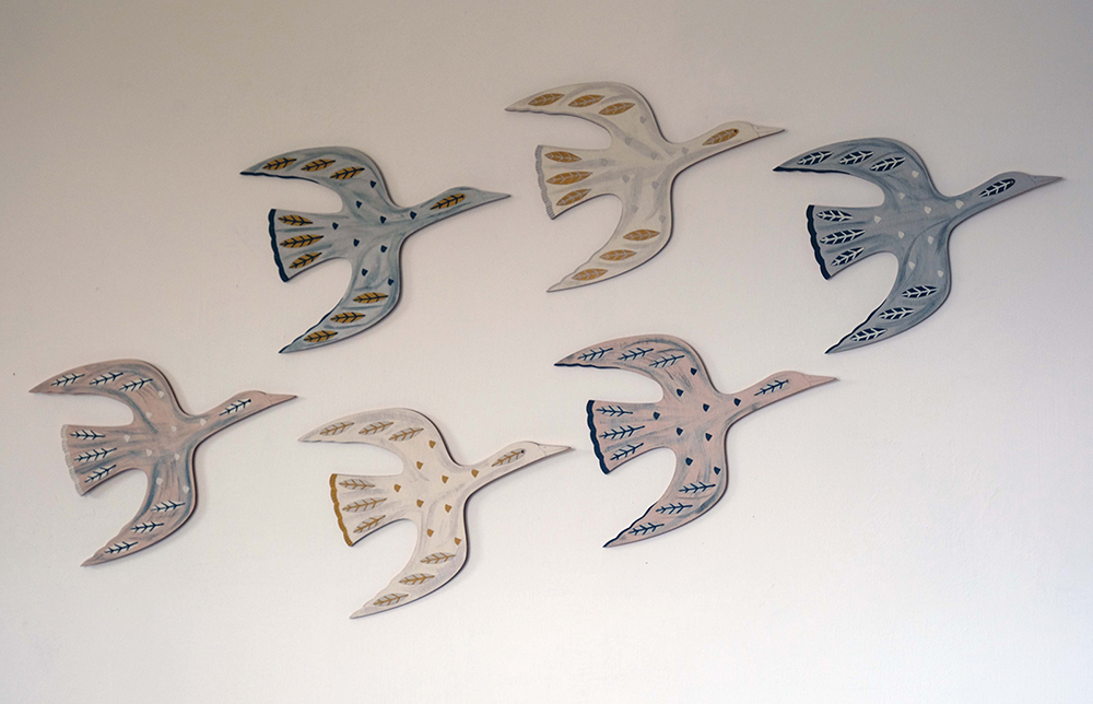 Geese flying on wall